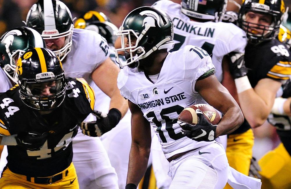 Dec 5, 2015; Indianapolis, IN, USA; Michigan State Spartans wide receiver Aaron Burbridge (16) runs the ball as Iowa Hawkeyes linebacker Ben Niemann (44) looks to defend during the first half in the Big Ten Conference football championship game at Lucas Oil Stadium. Mandatory Credit: Thomas J. Russo-USA TODAY Sports