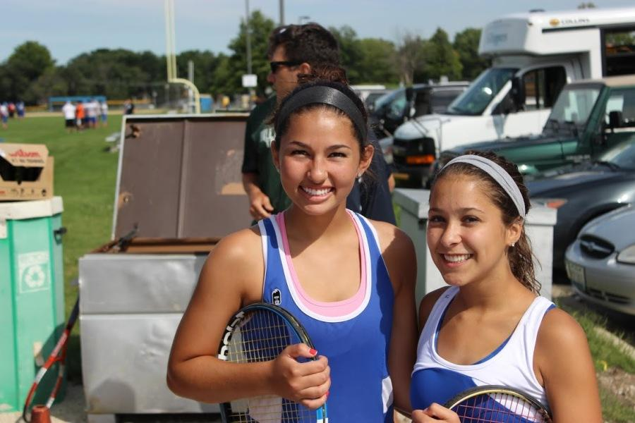 Senior Isabelle Gritsonis and Sarah Ziegler celebrate following their respective victories.