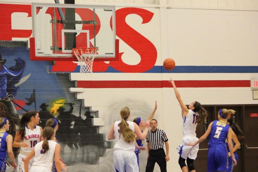 Senior guard Jenna Brambora fires a shot along the baseline