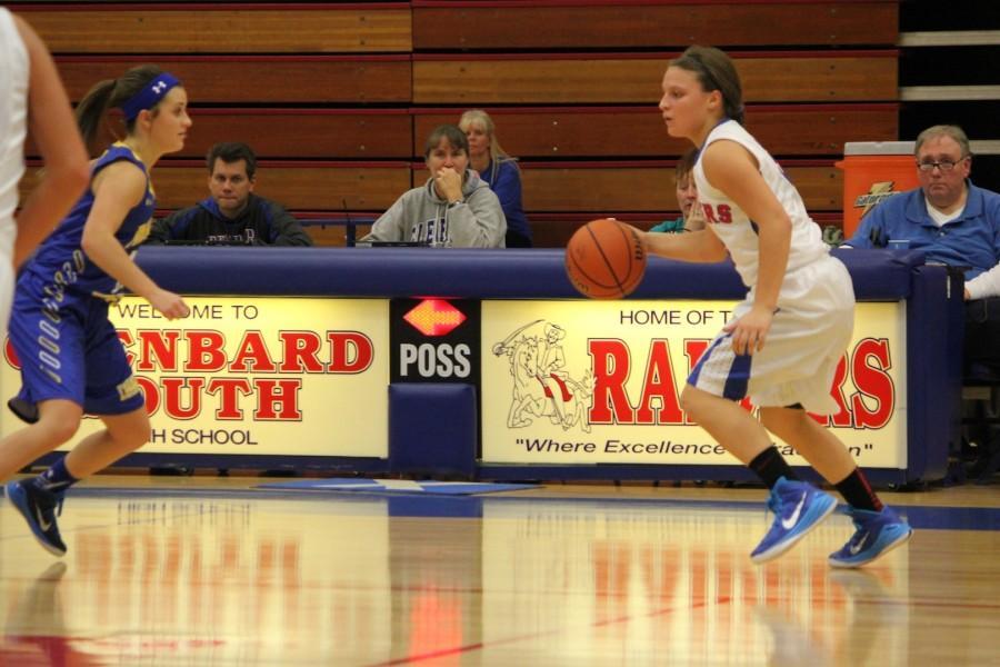 Junior guard Peyton Carli dribbles downcourt