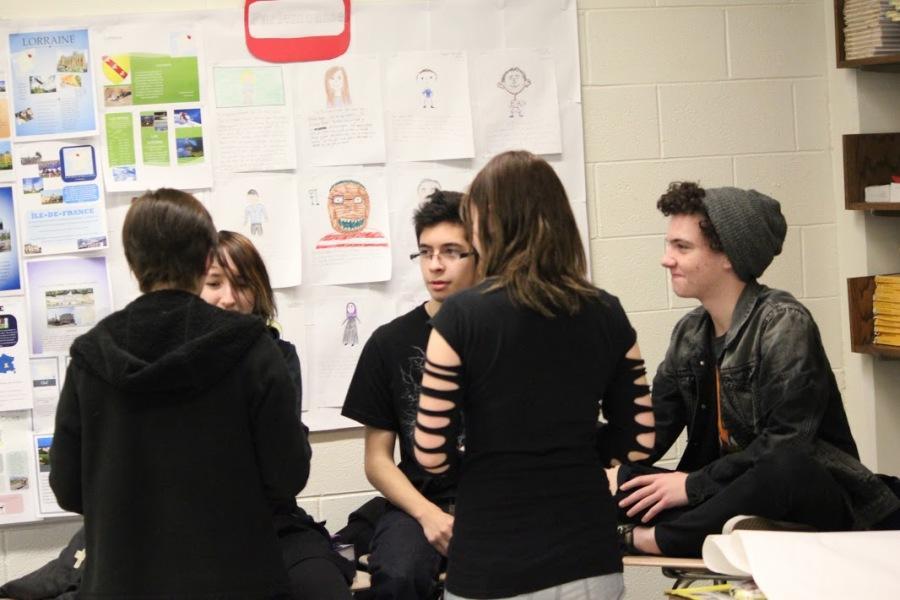 Students discuss various topics at a GSA meeting.