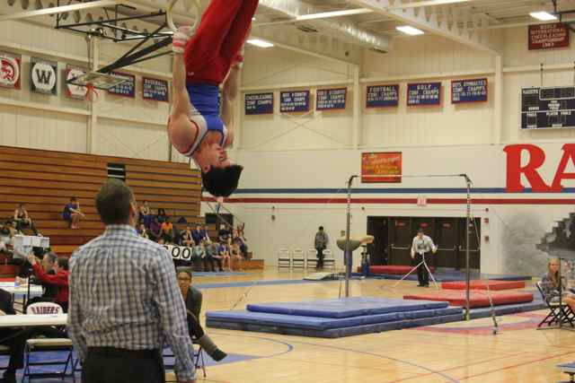 Senior Eric McGovern showcases his strength during his competition.