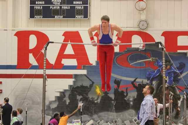 Senior Jimmy Glowacki pulls himself up during the high bar competition.