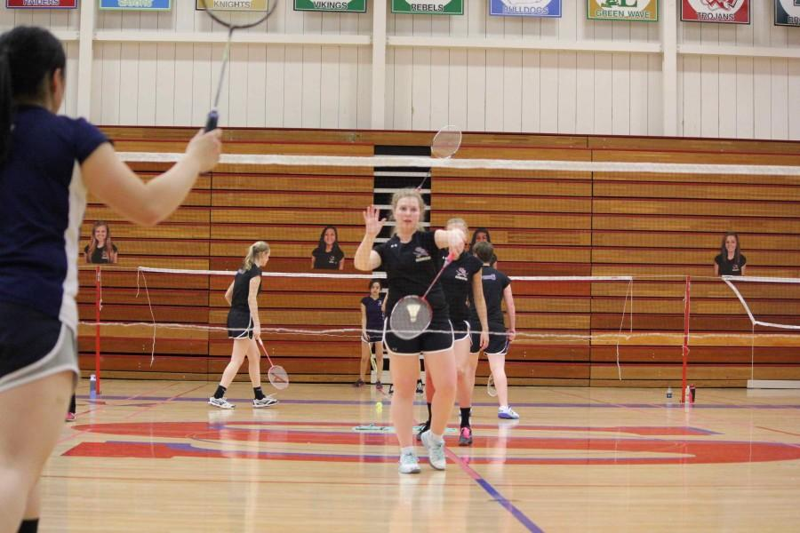Senior Emily Schmidt returns the birdie against her opponent.