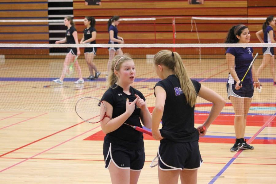 State-bound seniors Emily Schmidt and Lydia Schlaefke discuss strategy for the upcoming point.