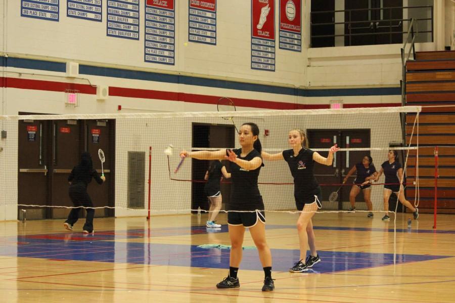 Seniors Rachel Rettger and Monique Martinez go for the winner.