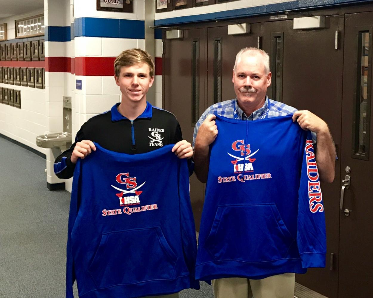 Sophomore state qualifier Alex Bergendorf and Coach Conrad proudly display their new sweatshirts. (Photo by Tim Carlson)
