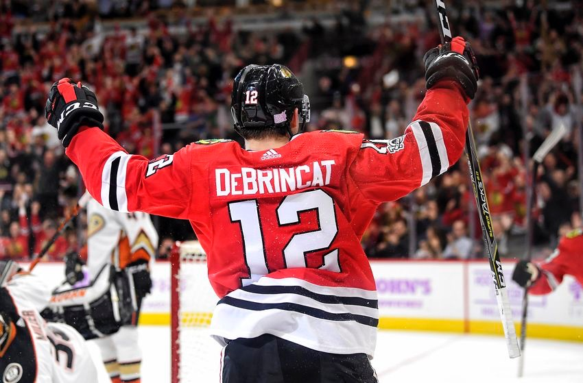 CHICAGO%2C+IL+-+NOVEMBER+27%3A+Chicago+Blackhawks+right+wing+Alex+DeBrincat+%2812%29+celebrates+with+teammates+after+scoring+a+goal+in+the+second+period+during+a+game+between+the+Chicago+Blackhawks+and+the+Anaheim+Ducks+on+November+27%2C+2017%2C+at+the+United+Center+in+Chicago%2C+IL.+%28Photo+by+Robin+Alam%2FIcon+Sportswire+via+Getty+Images%29