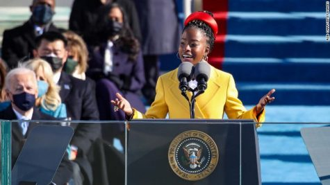 WASHINGTON, DC - JANUARY 20: Youth Poet Laureate Amanda Gorman speaks at the inauguration of U.S. President Joe Biden on the West Front of the U.S. Capitol on January 20, 2021 in Washington, DC.  During today